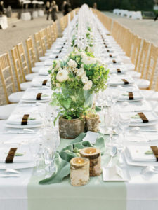 Image Source: AntiqueaholicsImage source: The Bridal ClosetImage Source: getmarried.com PhotoCourtesyof MarthaStewartWeddingsBy Red Letter EventsImage Courtesy: getmarried.com Or what about a mix of BOTH long and rounds tables!? Image source: Elizabeth Anne Designs At any rate Long tables can be beautiful and with the money you saved from not renting round tables and linens, you can spend that toward more elaborate things like lighting and chandeliers which really help to create ambiance at a reception venue.
